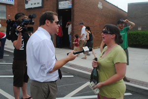 Hannah Withers speaking with a reporter during the block party